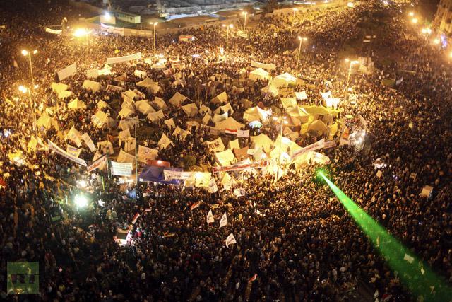 Anti-Mursi protesters chant anti-government slogans in Tahrir Square in Cairo