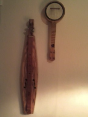 The Banjolele he got last year for Christmas as a restoration project and the Lap Dulcimer he made this year