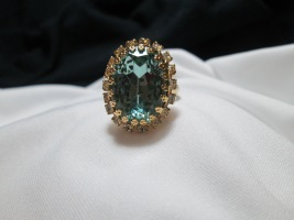 Costume Aquamarine ring, currently size 7, adjustable, New condition